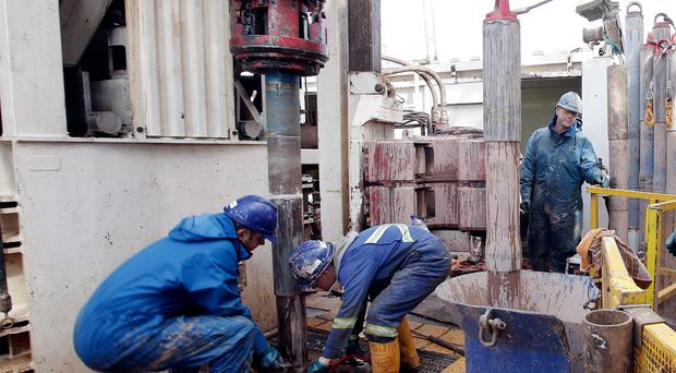 Engineers at work on the drilling platform of the Cuadrilla shale fracking facility in Lancashire