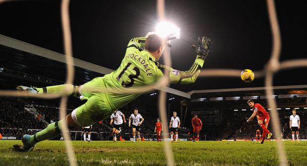 David Stockdale of Fulham dives as Steven Gerrard of Liverpool scores their third goal from the penalty spot during the Barclays Premier League match between Fulham and Liverpool at Craven Cottage on February 12, 2014 in London, England