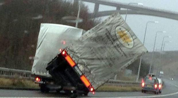 A lorry overturning on the M62 motorway at Scammoden water in West Yorkshire between Junction 22-23 Westbound. February 12, 2014.
