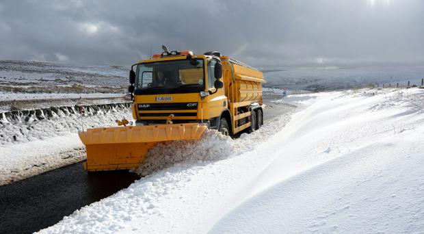 A snow plough clears snow on the Northumberland border. PRESS ASSOCIATION Photo.