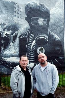 Bogside mural artists Tom Kelly (left) and Kevin Hasson welcomed the Housing Executive grant