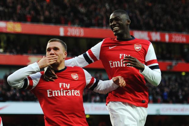 Lukas Podolski (L) of Arsenal celebrates with team mate Yaya Sanogo after scoring during the FA Cup Fifth Round match between Arsenal and Liverpool
