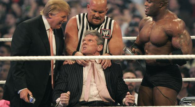 WWE chairman Vince McMahon (centre) has his head shaved by Donald Trump (left) and Bobby Lashley (right) while being held down by 'Stone Cold' Steve Austin. (Photo by Bill Pugliano/Getty Images)