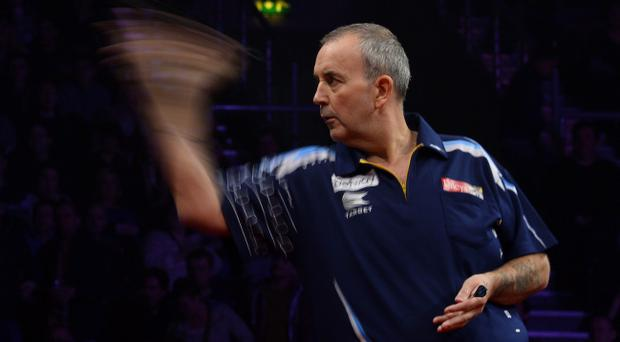 Betway Premier League Darts at The Odyssey Arena, Belfast. Phil 'The Power' Taylor gets his arm going