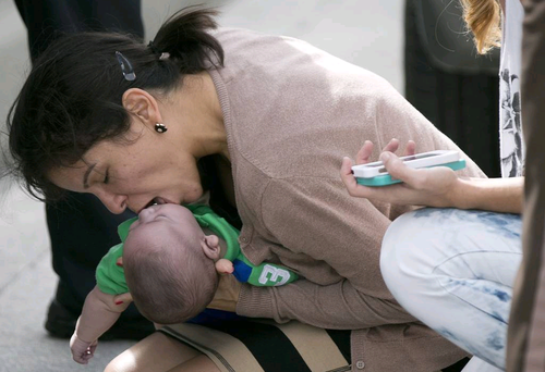 Pamela Rauseo performs CPR on her nephew, five-month-old Sebastian de la Cruz, after pulling her SUV over on the side of the road along the west bound lane on Florida state road 836 just east of 57th Avenue AP Photo/Miami Herald, Al Diaz