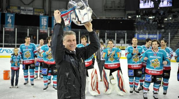 21/2/14: Paul Adey, coach of the Belfast Giants celebrating with the Elite League trophy after the game against the Coventry Blaze at the Odyssey Arena, Belfast.