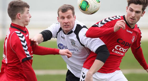 Action from Lisburn Distillery vs Larne in the Belfast Telegraph Championship One