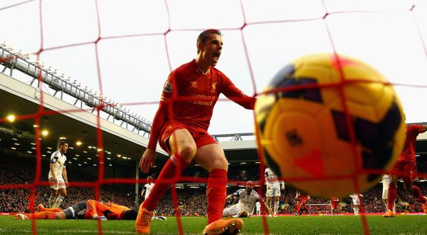 LIVERPOOL, ENGLAND - FEBRUARY 23: Jordan Henderson of Liverpool celebrates scoring the winning goal during the Barclays Premier League match between Liverpool and Swansea City at Anfield on February 23, 2014 in Liverpool, England. (Photo by Clive Brunskill/Getty Images)