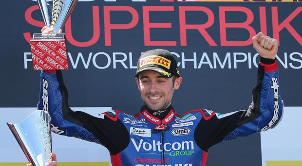 PHILLIP ISLAND, AUSTRALIA - FEBRUARY 23: Eugene Laverty of Ireland and Voltcom Crescent Suzuki celebrates on the podium after winning race 1 during round one of the 2014 World Superbike Championship at Phillip Island Grand Prix Circuit on February 23, 2014 in Phillip Island, Australia. (Photo by Scott Barbour/Getty Images)