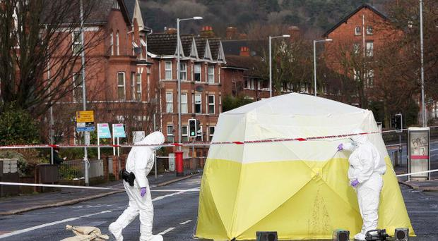 A forensic officer at the scene on the Antrim Road in north Belfast where four men were attacked in the early hours of Sunday morning with one man critically ill in hospital. Jonathan Porter/Presseye