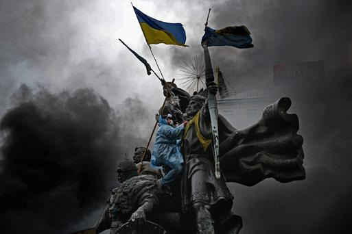 Anti-government protesters, continue to their clash with police in Independence square, despite a truce agreed between the Ukrainian president and opposition leaders on February 20, 2014 in Kiev, Ukraine. Photo by Jeff J Mitchell