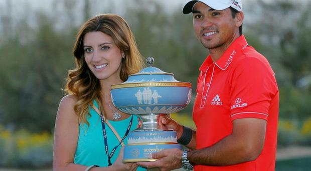Jason Day, of Australia, and his wife, Ellie, poses with the trophy after winning his championship match against Victor Dubuisson