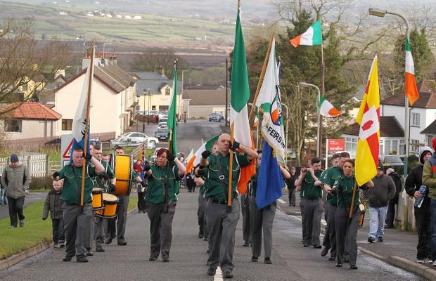 30th anniversary parade for IRA members Henry Hogan and Declan Martin in Dunloy who were shot dead by the British Army in the Co. Antrim village in 1984. The parade makes its way through the village.