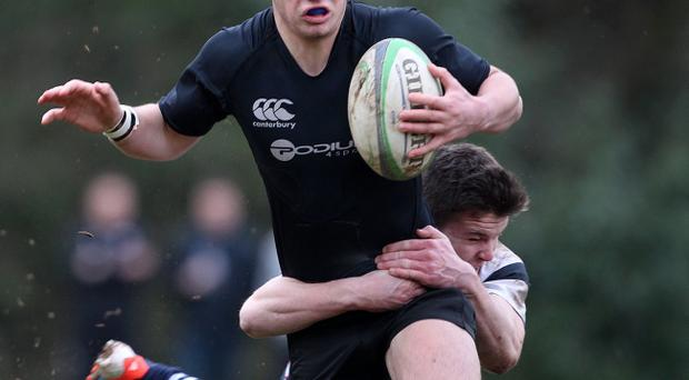Campbell College's Gareth Peden and Wallace's Jacob Stockdale during Saturday's Danske Bank quarter final at Fox's Field