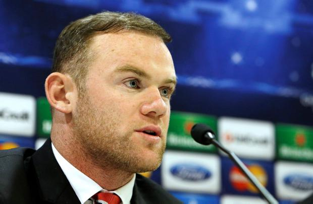 Manchester United's player Wayne Rooney attends a news conference at Georgios Karaiskakis stadium, in Piraeus port, near Athens, on Monday, Feb. 24, 2014.  Manchester United will play against Olympiakos in the Champions League's round of 16 on Tuesday. (AP Photo/Thanassis Stavrakis)