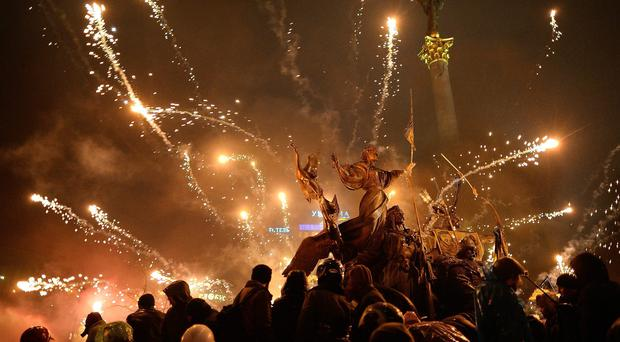 Chaos: Anti-government protesters let off fireworks during demonstrations in Independence Square in Kiev, Ukraine