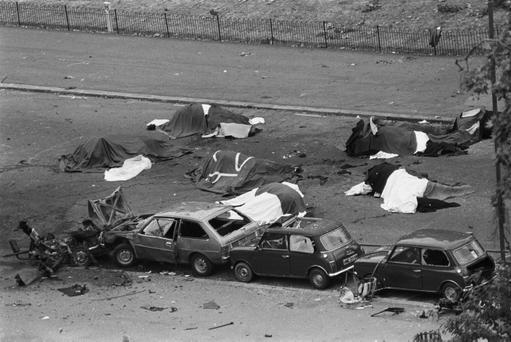 Dead horses covered up and wrecked cars at the scene after an IRA bomb exploded as the Household Cavalry was passing, in Hyde Park, London.