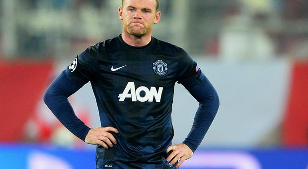 PIRAEUS, GREECE - FEBRUARY 25: Wayne Rooney of Manchester United reacts during the UEFA Champions League Round of 16 first leg match between Olympiacos FC and Manchester United at Karaiskakis Stadium on February 25, 2014 in Piraeus, Greece. (Photo by Michael Regan/Getty Images)
