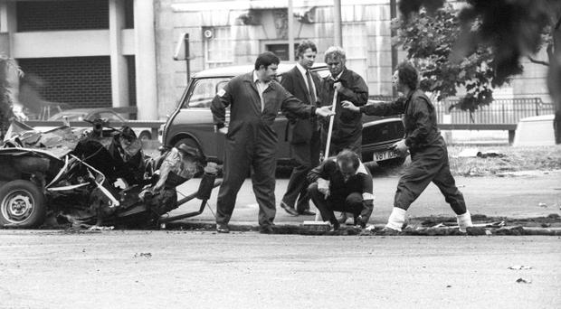 Police forensic officers working on the remains of the IRA car which housed the Hyde Park car bomb in which four soldiers died