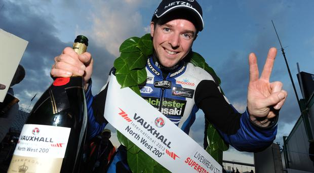 Alastair Seeley celebrates winning the Superstock race at the Vauxhall International North West 200in 2014. Will he be a winner in 2014? Picture by Stephen Davison