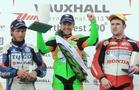 Alastair Seeley celebrates after winning the opening Supersport race at the Vauxhall International North West 200 in 2013 with Michael Dunlop and Guy Martin. Picture by Stephen Davison