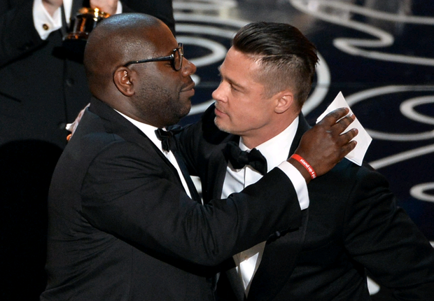Director Steve McQueen (L) and actor/producer Brad Pitt accept the Best Picture award for '12 Years a Slave' onstage during the Oscars at the Dolby Theatre on March 2, 2014 in Hollywood, California. (Photo by Kevin Winter/Getty Images)