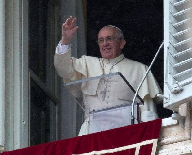 Pope Francis blesses faithful during the Angelus prayer from his studio window overlooking St. Peter's Square at the Vatican, Sunday, March 2, 2014. (AP Photo/Alessandra Tarantino)