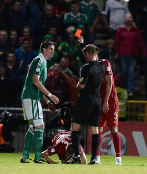 Kyle Lafferty sees red after lunging at Joao Pereira