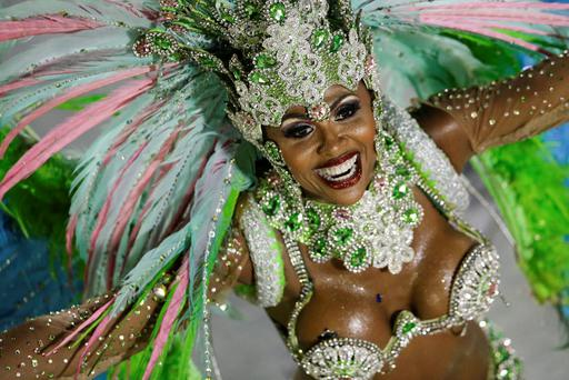 A performer from the Mangueira samba school parades during carnival celebrations at the Sambadrome in Rio de Janeiro, Brazil, Monday, March 3, 2014. (AP Photo/Felipe Dana)