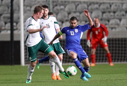 Northern Ireland's Chris Brunt & Ollie Norwood and Cyprus' Constantinos. Pic Sakis Savvides/Pacemaker Press