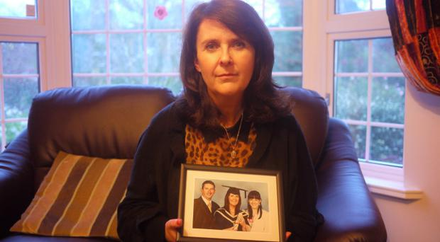 Catherine McKee with a photograph of her daughter Niamh Louise (right) before her death in 2005