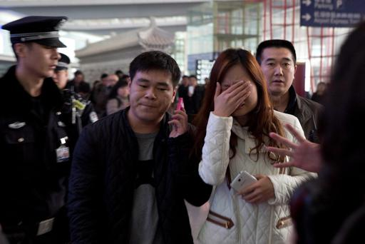 A woman cries at the arrival hall of the International Airport in Beijing, China, Saturday, March 8, 2014. Relatives and friends were arriving at Beijing airport for news after a Malaysia Airlines Boeing 777-200 was reported missing on a flight from Kuala Lumpur to Beijing Saturday. (AP Photo/Ng Han Guan)