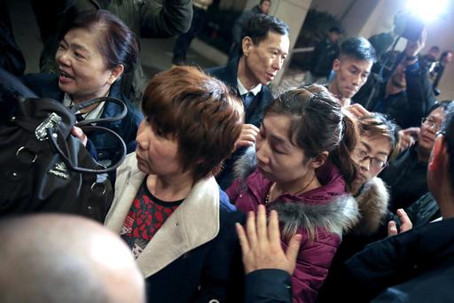 BEIJING, CHINA - MARCH 09: Relatives of passengers onboard Malaysia Airlines flight MH370 leave after applying for their Chinese passports to be ready to travel to the crash site as the search continues for the missing Malaysian airliner on March 9, 2014 in Beijing, China. Malaysia Airline Flight MH370 from Kuala Lumpur to Beijing and carrying 239 onboard was reported missing on early on March 8 after the crew failed to check in as scheduled while flying over the sea between Malaysia and Ho Chi Minh City in Vietnam. (Photo by Lintao Zhang/Getty Images)