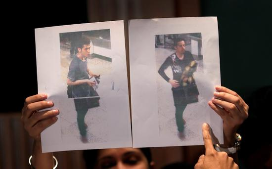 Pictures of the two men, a 19-year old Iranian, identified by Malaysian police as Pouria Nour Mohammad Mehrdad, left, and the man on the right, his identity still not released