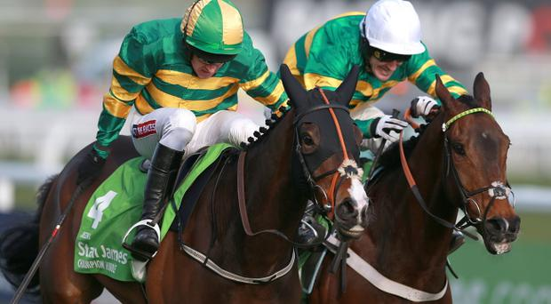 Jezki ridden by Barry Geraghty on their way to winning the Stan James Champion Hurdle Challenge Trophy from My Tent Or Yours ridden by Tony McCoy (right) during Champion Day at Cheltenham Racecourse, Cheltenham.