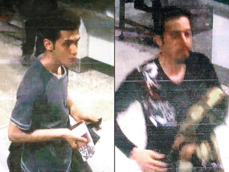 Iranian passengers Pouria Nour Mohammad Mehrdad and Delavar Seyedmohammaderza board the now missing Malaysia Airlines jet MH370 with stolen passports. (AP Photo/Interpol)