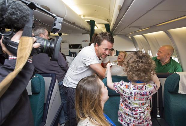 Graeme McDowell speaks to children on the flight to Florida