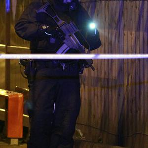 A police officer patrols the area close to the scene of a bomb