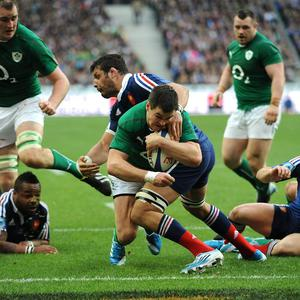 Ireland's Jonathan Sexton dives in to score a try during the Six Nations match at the Stade de France, Paris, France.