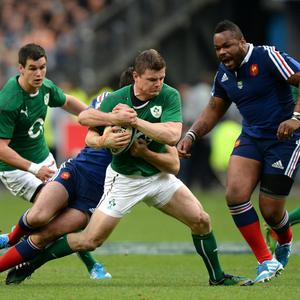 Ireland's Brian O'Driscoll is tackled by France's Remi Tales during the Six Nations match at the Stade de France, Paris, France
