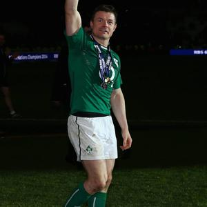 Brian O'Driscoll of Ireland celebrates after winning the Six Nations Championship during the RBS Six Nations match between France and Ireland at Stade de France on March 15, 2014 in Paris, France.