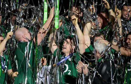 Ireland's Paul O'Connell lifts the 6 Nations trophy after the Six Nations match at the Stade de France, Paris, France.