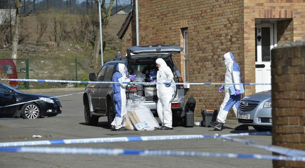 Police and scene of crime teams pictured at a flat in Ardoyne Place in Belfast where the body of a man was found. Pic Stephen Hamilton/Presseye
