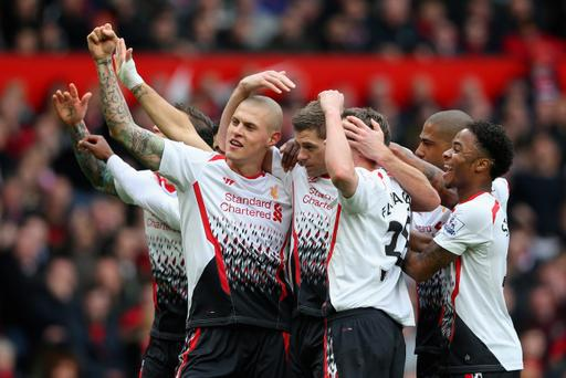 Steven Gerrard of Liverpool celebrates scoring the first goal with his team-mates during the Barclays Premier League match between Manchester United and Liverpool at Old Trafford
