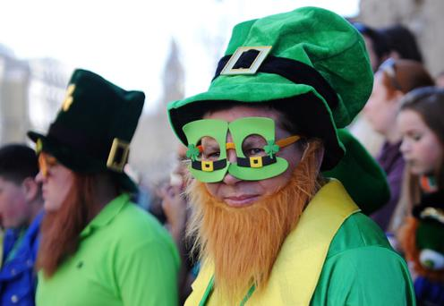LONDON, ENGLAND - MARCH 16: A man dressed in an Irish themed costume watches the annual St Patrick's Day Festival pass from Piccadilly to Trafalgar Square through Haymarket on March 16, 2014 in London, England. (Photo by Stuart C. Wilson/Getty Images)