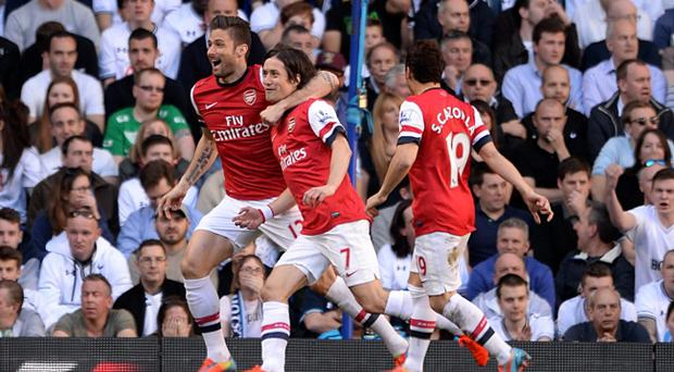 Arsenal's Tomas Rosicky celebrates scoring the opening goal of the game during the Barclays Premier League match at White Hart Lane