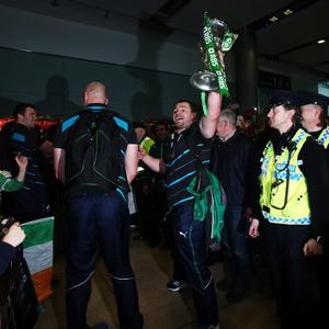 Cian Healy lifts the 6 nations trophy as the Ireland team arrive at Dublin Airport, Ireland.