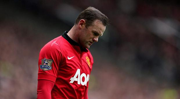 Wayne Rooney and Manchester United suffered a humiliating 3-0 defeat at Old Trafford to fierce rivals Liverpool