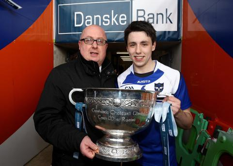 Danske Bank's Danny Stinton, Head of Business Development, Business Banking presents St Patrick's captain Peter Hagan with the Danske Bank MacRory Cup after the St Patrick's Day final at Armagh's Athletic Grounds