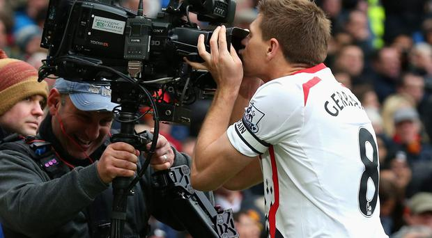 Steven Gerrard of Liverpool celebrates scoring the second goal by kissing the steadicam during the Barclays Premier League match between Manchester United and Liverpool at Old Trafford on March 16, 2014 in Manchester, England. (Photo by Alex Livesey/Getty Images)